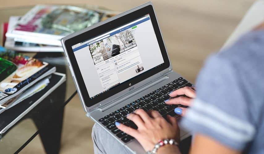 Women using Facebook on her laptop